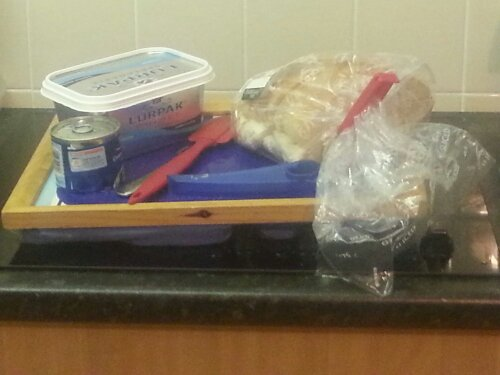 image shows tray laden with utensils and ingredients needed to make lunch